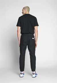 Carhartt WIP - COLTER PANT - Trousers - black/white - 2