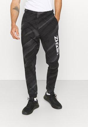 PANT ENERGY - Tracksuit bottoms - black/white