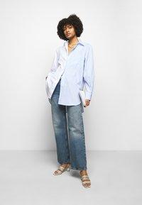 House of Dagmar - ALBA - Flared jeans - medium blue - 1