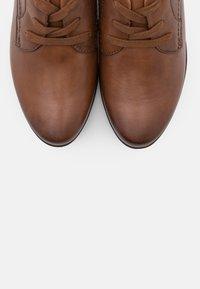 Jana - Ankle boot - cognac - 5