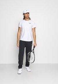 Nike Performance - HERITAGE SUIT PANT - Verryttelyhousut - black - 1