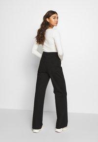 Gina Tricot - WIDE LEG  - Flared jeans - black - 2