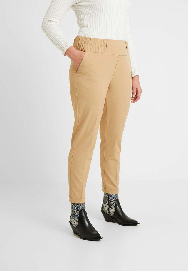 NAJA PANTS - Trousers - tannin