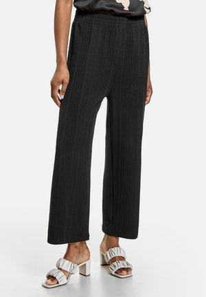 STRUKTUR - Trousers - black