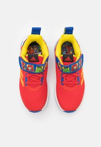 adidas Performance - FORTARUN SUPERHERO UNISEX - Neutral running shoes - vivid red/team royal blue/footwear white - 3