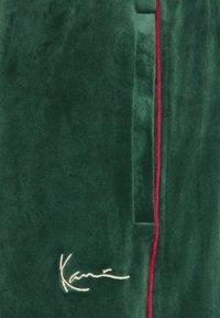 Karl Kani - UNISEX - Tracksuit bottoms - darkgreen - 2