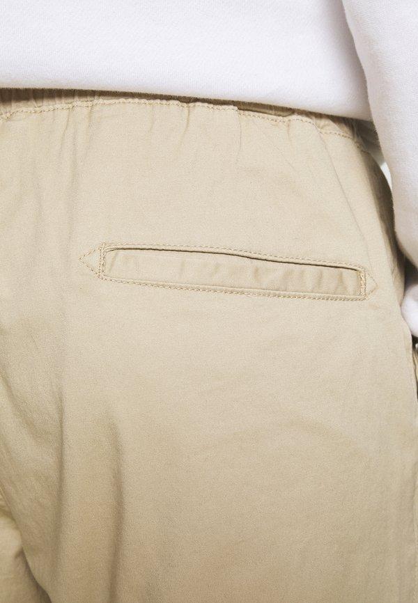Champion Rochester ELASTIC CUFF PANTS - Spodnie treningowe - beige/beżowy Odzież Męska HHBT
