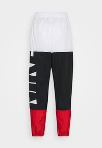 Nike Performance - STARTING PANT - Tracksuit bottoms - white/black/university red - 7