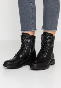 Apple of Eden - TAY - Lace-up ankle boots - black - 0