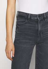 American Eagle - SUPER HI-RISE - Slim fit jeans - blue black - 5