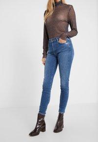 Agolde - SOPHIE SKINNY - Jeans Skinny Fit - tame - 0