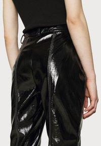 NA-KD - CONTRAST SEAM PANTS - Trousers - black - 4