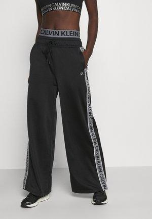 PANT - Verryttelyhousut - black/bright white