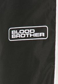 Blood Brother - VALENCE UNISEX - Tracksuit bottoms - black/beige - 2