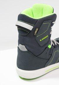 Lowa - RAIK GTX UNISEX - Winter boots - navy/limone - 5