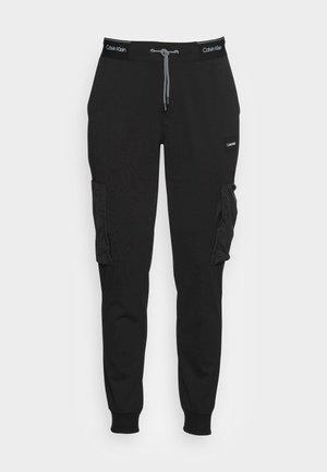 RECYCLED MIX MEDIA - Pantalon de survêtement - black