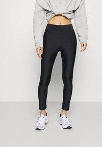Monki - FRIDA SHINY - Leggings - Trousers - black dark - 0