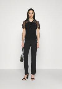 Morgan - DAYANA - Print T-shirt - noir - 1
