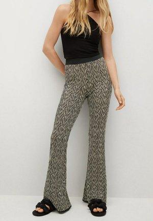 CEBRIAN - Trousers - black/beige