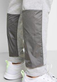 adidas Performance - MUST HAVES AEROREADY SPORTS REGULAR PANTS - Tracksuit bottoms - mottled dark grey - 3