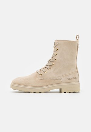CLEAT BOOT - Lace-up ankle boots - beige