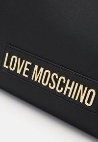 Love Moschino - BORSA SMOOTH - Handbag - black - 4