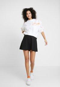 Puma - CLASSICS SHORTSLEEVE DRESS - Vestido ligero - black - 1