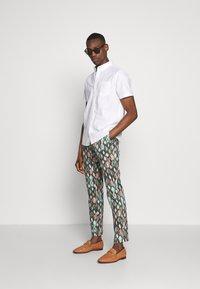 Bertoni - BLOCH TROUSER EXCLUSIVE - Trousers - black - 1