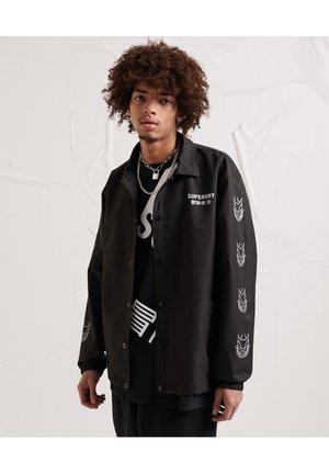 SUPERDRY UNISEX ENERGY OPPOSITION COACH JACKET - Light jacket - black