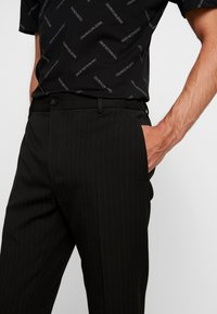 Calvin Klein Tailored - PINSTRIPE TROUSER CASUAL - Trousers - black - 3