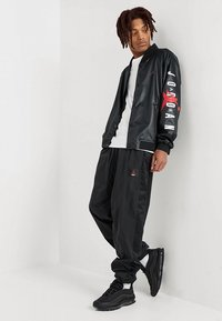 Jordan - FLIGHT WARM UP PANT - Tracksuit bottoms - black - 1