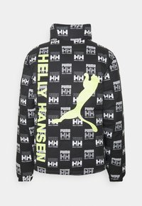Puma - HELLY HANSEN REVERSIBLE JACKET - Winter jacket - white - 1