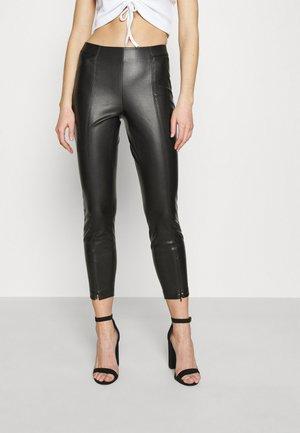 ONLTEA MIRI - Leggings - Trousers - black