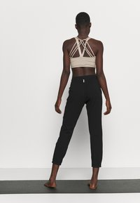 Deha - PANTS - Tracksuit bottoms - black - 2