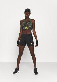 adidas Performance - TIRO PRIDE - Pantalón corto de deporte - black - 1