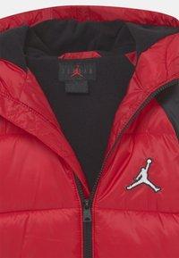 Jordan - FLIGHT PUFFER UNISEX - Giacca invernale - gym red - 2