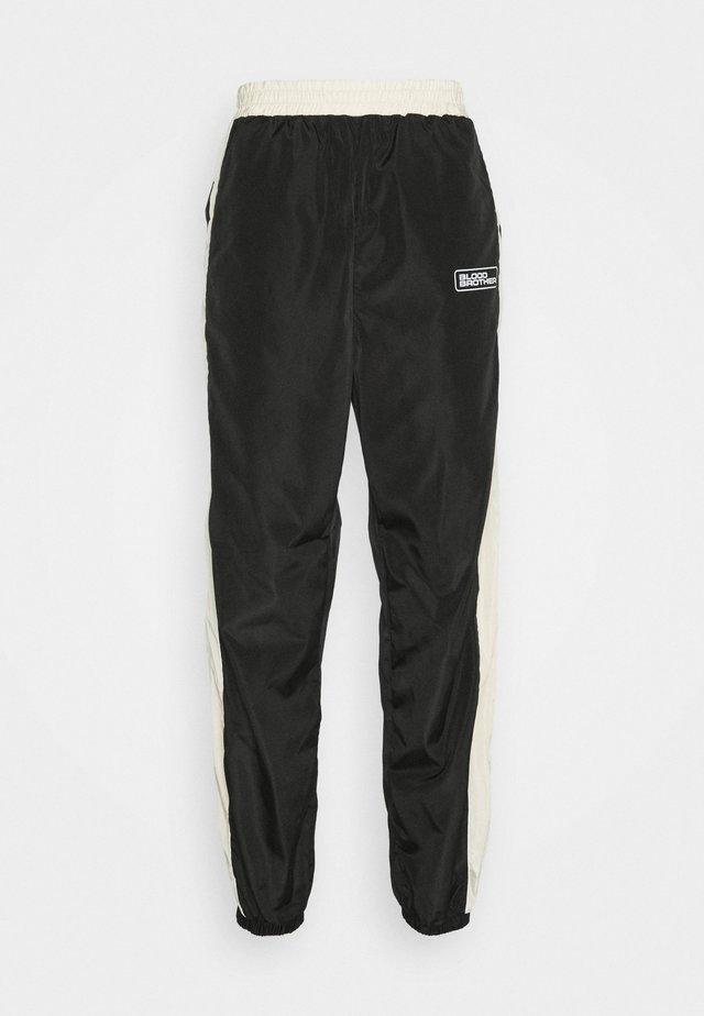 VALENCE UNISEX - Pantalones deportivos - black/beige