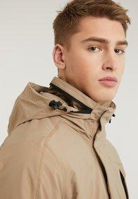 CHASIN' - SATURN LIGHT - Short coat - beige - 8