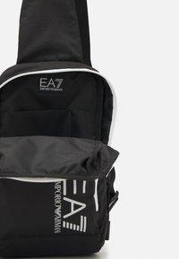 EA7 Emporio Armani - UNISEX - Across body bag - black/white - 3