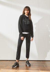 Replay - ROSE COLLECTION PANTS - Pantaloni sportivi - black - 1