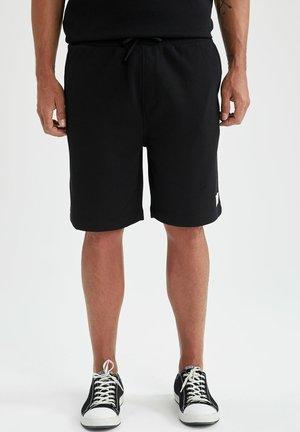 RELAX FIT - Spodnie treningowe - black