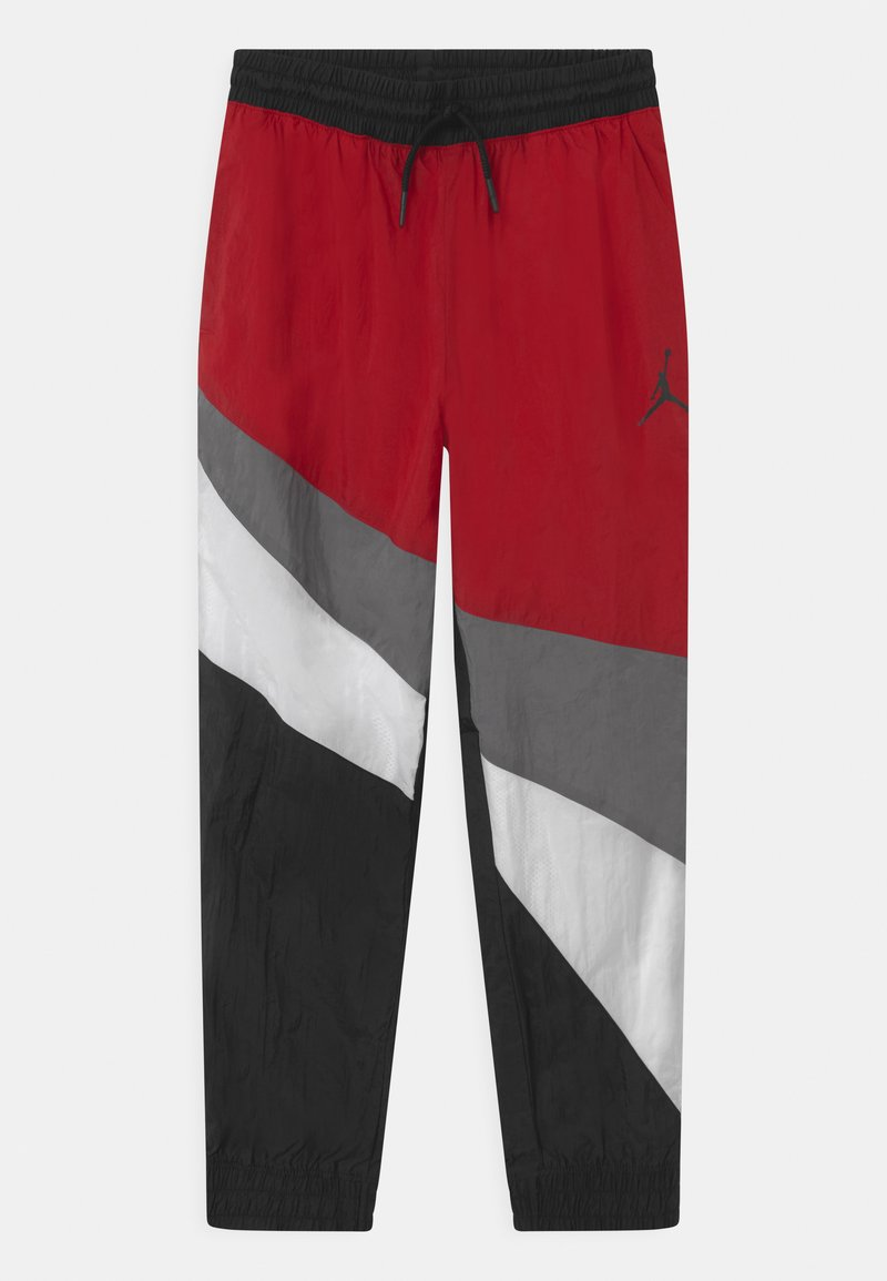 Jordan - JUMPMAN WAVE WIND - Tracksuit bottoms - gym red