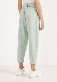 Bershka - SLOUCHY - Trousers - turquoise - 2