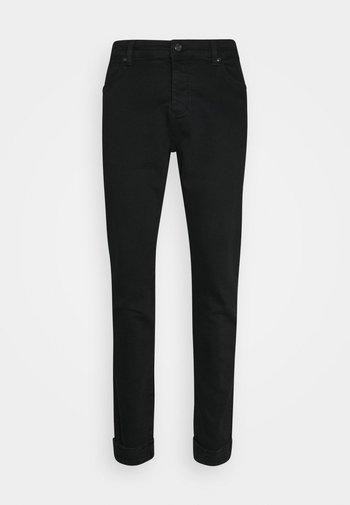 ELASTICATED STRAP CUFF - Jeans slim fit - black
