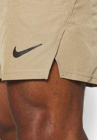 Nike Performance - Sports shorts - parachute beige/black - 5