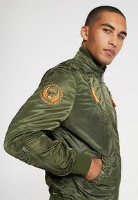 Alpha Industries - Bomber Jacket - dark green - 3