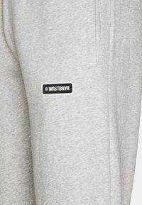WRSTBHVR - PANTS ROY UNISEX - Tracksuit bottoms - grey - 5