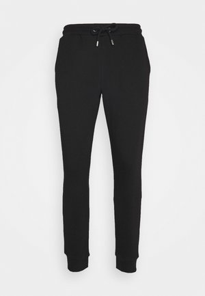 PANTS - Tracksuit bottoms - black/white