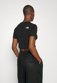 The North Face - CROP TEE - T-shirt con stampa - black - 3