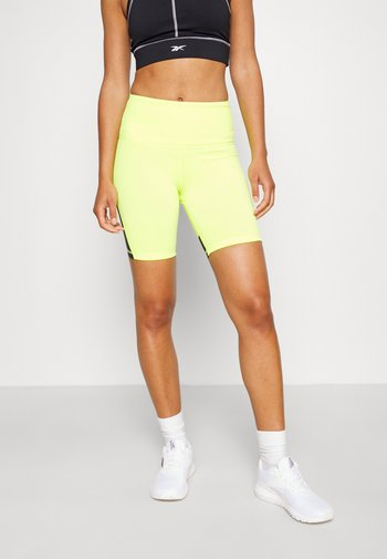 BEYOND THE SWEAT SHORT - Leggings - yellow flare